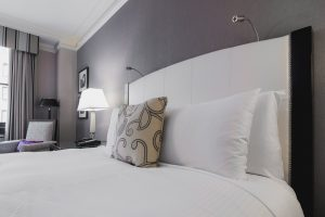 A bright hotel room with a bed