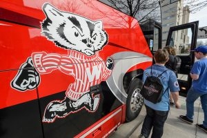 Students entering a Badger Bus